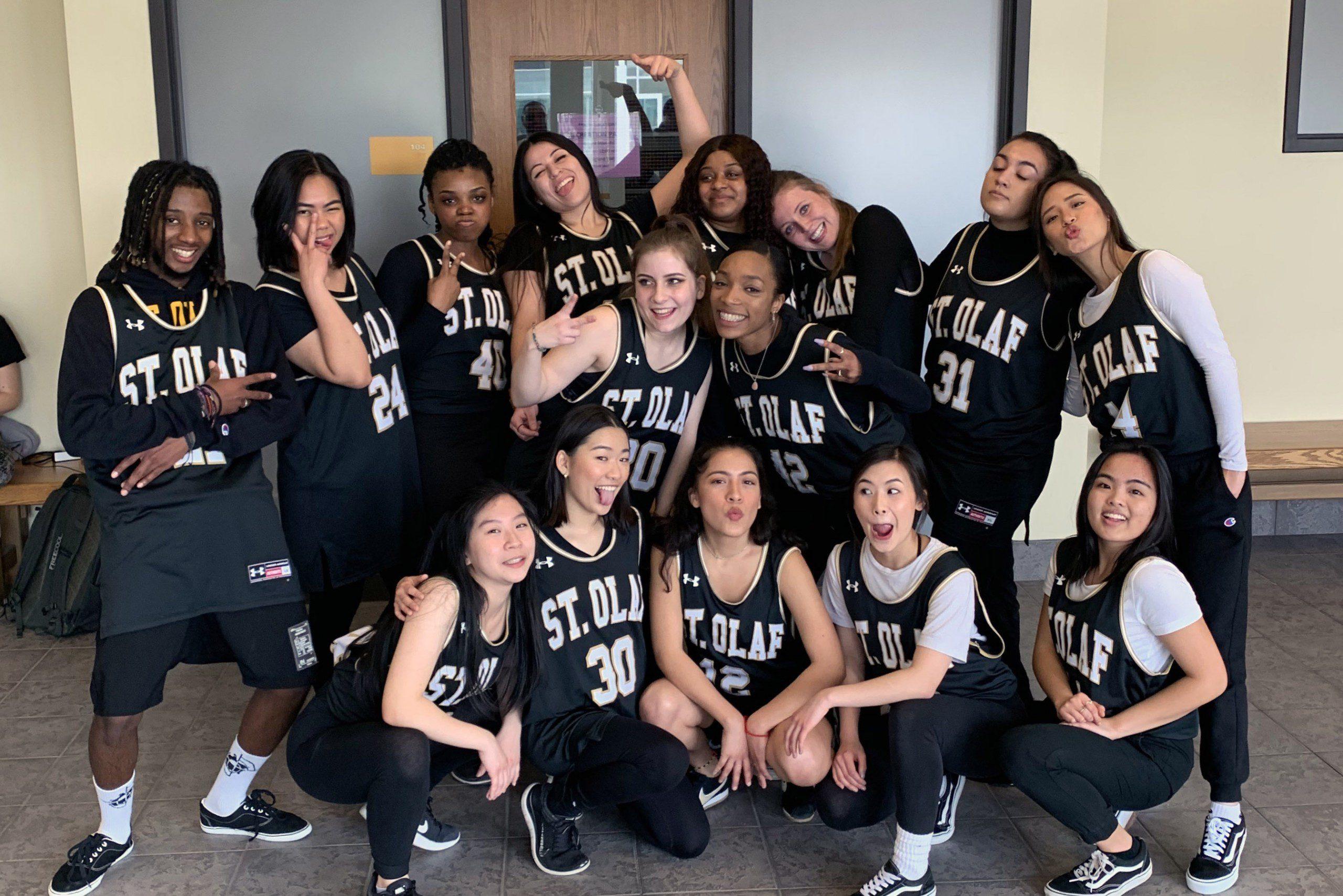 Portrait of M.I.X. members posing in basketball jerseys.