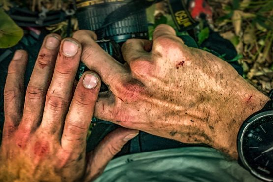 Photo of Kyle Obermann's hands holding a camera.