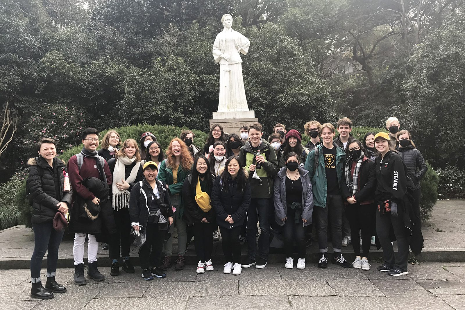 Asian Conversations students gather in front of the statue of Qiu Jin in Hangzhou, China, during Interim 2020. Photo courtesy of Clare Wongwai '22