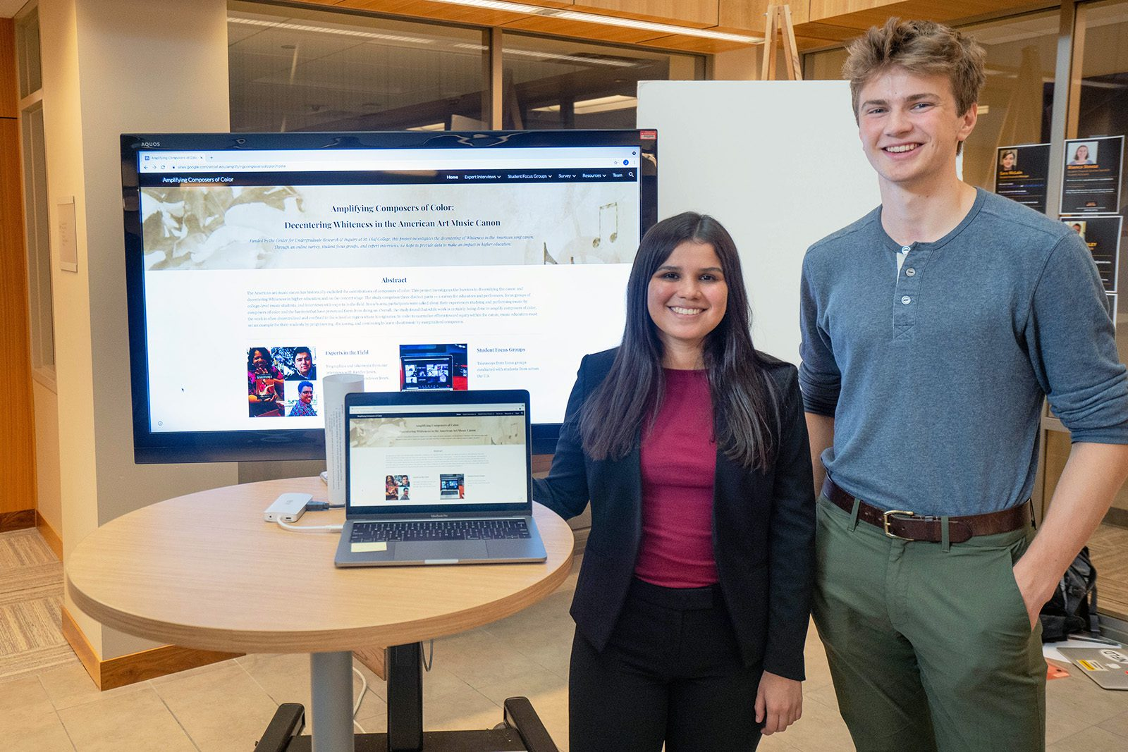 """Jimena Fernández '22 (left) and Elijah Leer '22 (right) present their Collaborative Undergraduate Research and Inquiry (CURI) project titled """"Amplifying Composers of Color: Decentering Whiteness in the American Art Music Canon."""""""