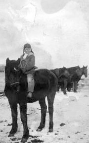 A young Rusty Houtz on horseback, circa 1930