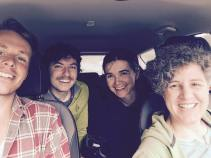 Four people in car take a selfie