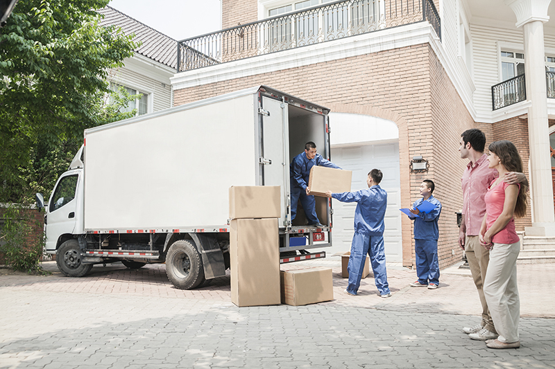 Movers loading moving truck