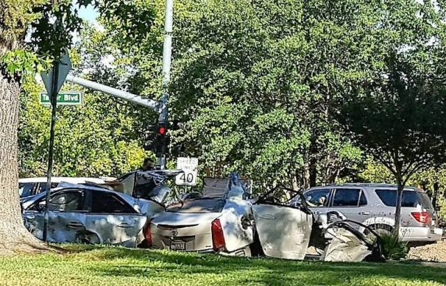 Witnesses say a man ran from the wreckage of this car Monday. Photo: Pamela Dunn