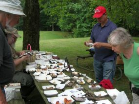 Identifying mushrooms at the Fornof Foray. By Dick Dougall.
