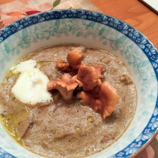 Finished soup with a spoonfull of mascarpone, pickled chanterelles and truffle oil. By Richard Jacob