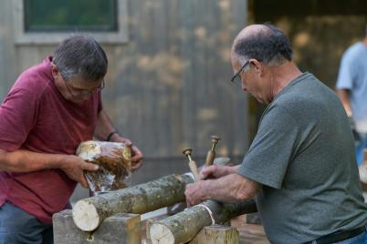 Inoculating logs. By Kristine Murawski