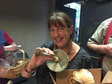 Mary Jo Smiley with a Green-Spored Lepiota. By Richard Jacob