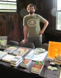 Jared Delaney at the Sales Table. By Cecily Franklin