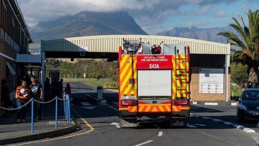 An emergency vehicle leaves the Rheinmetall Denel Munition depot, at Somerset West, near Cape Town, South Africa, Monday, Sept. 3, 2018. Authorities say at least 8 people have been killed in an explosion at the munitions plant with investigators trying to determine the cause of the blast which shook homes and rattled windows in the area. (AP Photo)