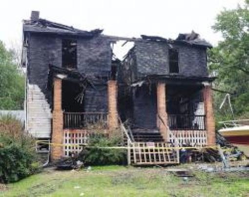 A fire early Saturday morning destroyed this home on the 5000 block of Route 982 in Derry Township and displaced the family of Marissa Bolish, 17, who was killed Aug. 29 in a car crash along Route 982 in Latrobe. Her father, Michael Bolish III, suffered burns and injuries diving through a front window to escape the fire. State police fire marshals are still working to determine the cause of the blaze.  Photo by Jim Bates