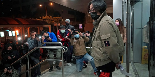 Mike Lam King-nam, who participated in the pro-democracy primary elections, leaves police station after being bailed out in Hong Kong, Thursday, Jan. 7, 2021. (AP Photo/Kin Cheung)