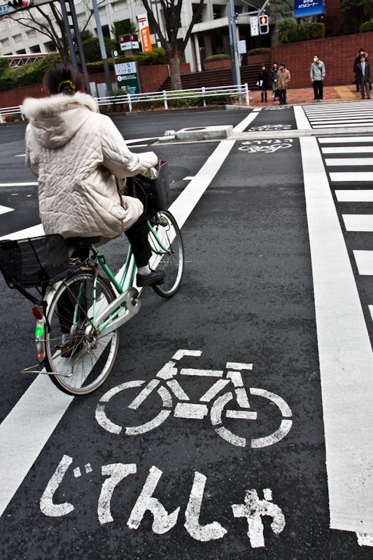 bicycle crossing shinjuku tokyo width=