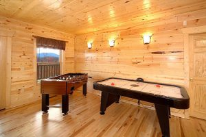 A shuffleboard & foosball table in the game room at Elk Ridge Lodge