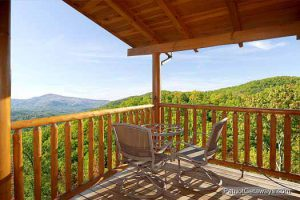 Bistro set on a covered deck overlooking the view at a cabin called Flying with Eagles, a Pigeon Forge cabin rental.