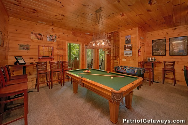 A pool table and foosball table at Bear House Retreat - a Pigeon Forge cabin rental
