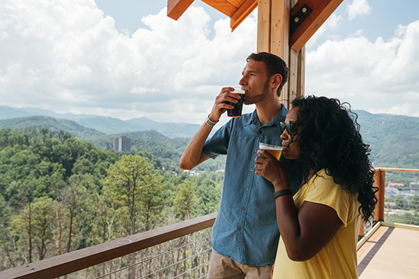 a man and woman drinking beer at Anakeesta