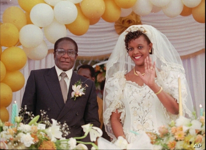 Grace Marufu, the new bride of Zimbabwean President Robert Mugabe, right, waves at guests Saturday, Aug. 17, 1996, after their wedding ceremony at the Kutama catholic mission 42 miles, (80kms )west of Harare. Decades of disputes with the Roman Cathol