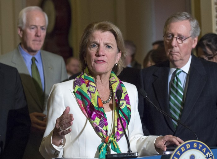 Sen. Shelly Moore Capito, R-W.Va., accompanied by Senate Majority Leader Mitch McConnell of Ky., right, and Senate Majority Whip John Cornyn of Texas, speaks to reporters on Capitol Hill in Washington, Tuesday, March 17, 2015, following a policy…