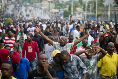 Demonstrators chant anti-government slogans during a protest against fuel shortages and to demand the resignation of President Jovenel Moise, in Port-au-Prince, Haiti, Friday, Sept. 20, 2019.