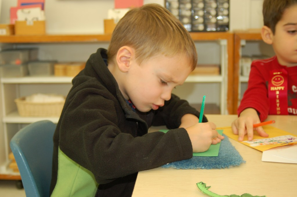 Young Montessori Student At Work