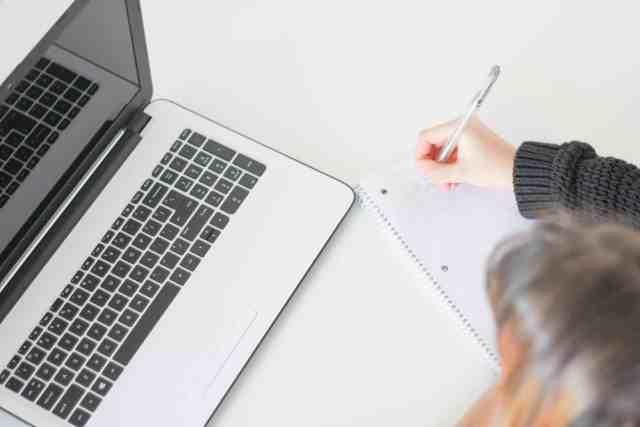 Woman writing article