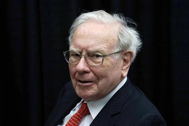 Berkshire Hathaway CEO Warren Buffett plays bridge during the Berkshire annual meeting weekend in Omaha