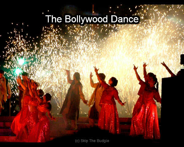Bollywood dance, dance classes and more. In the image we show ladies dancing at a dramatic moment.