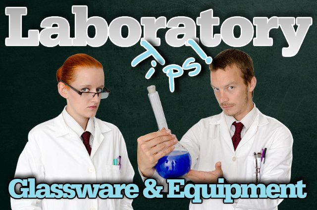 Two laboratory technicians hold up a reactor vessel to introduce our laboratory glassware and equipment article.