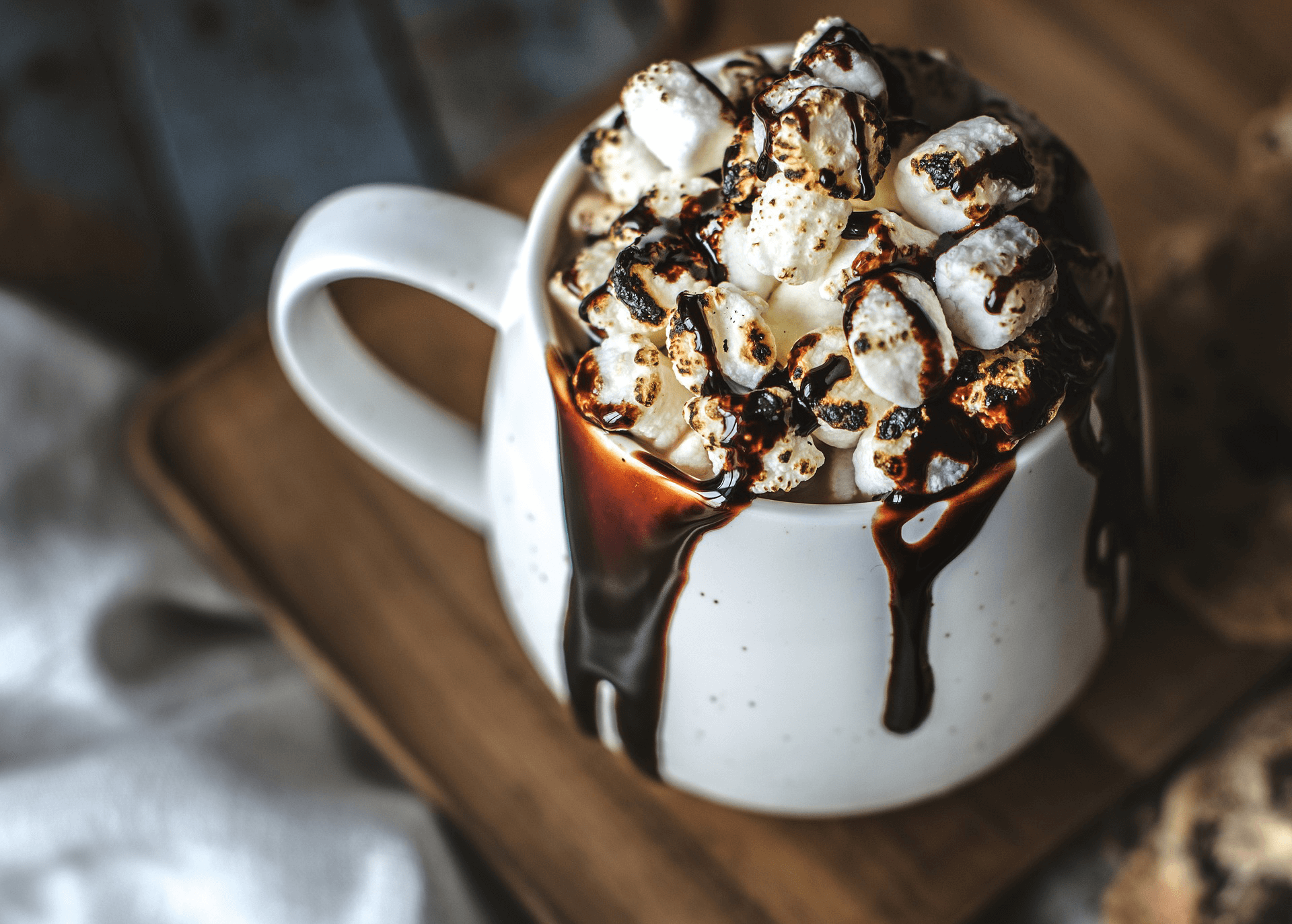A PNG of chocolate with marshmellows.