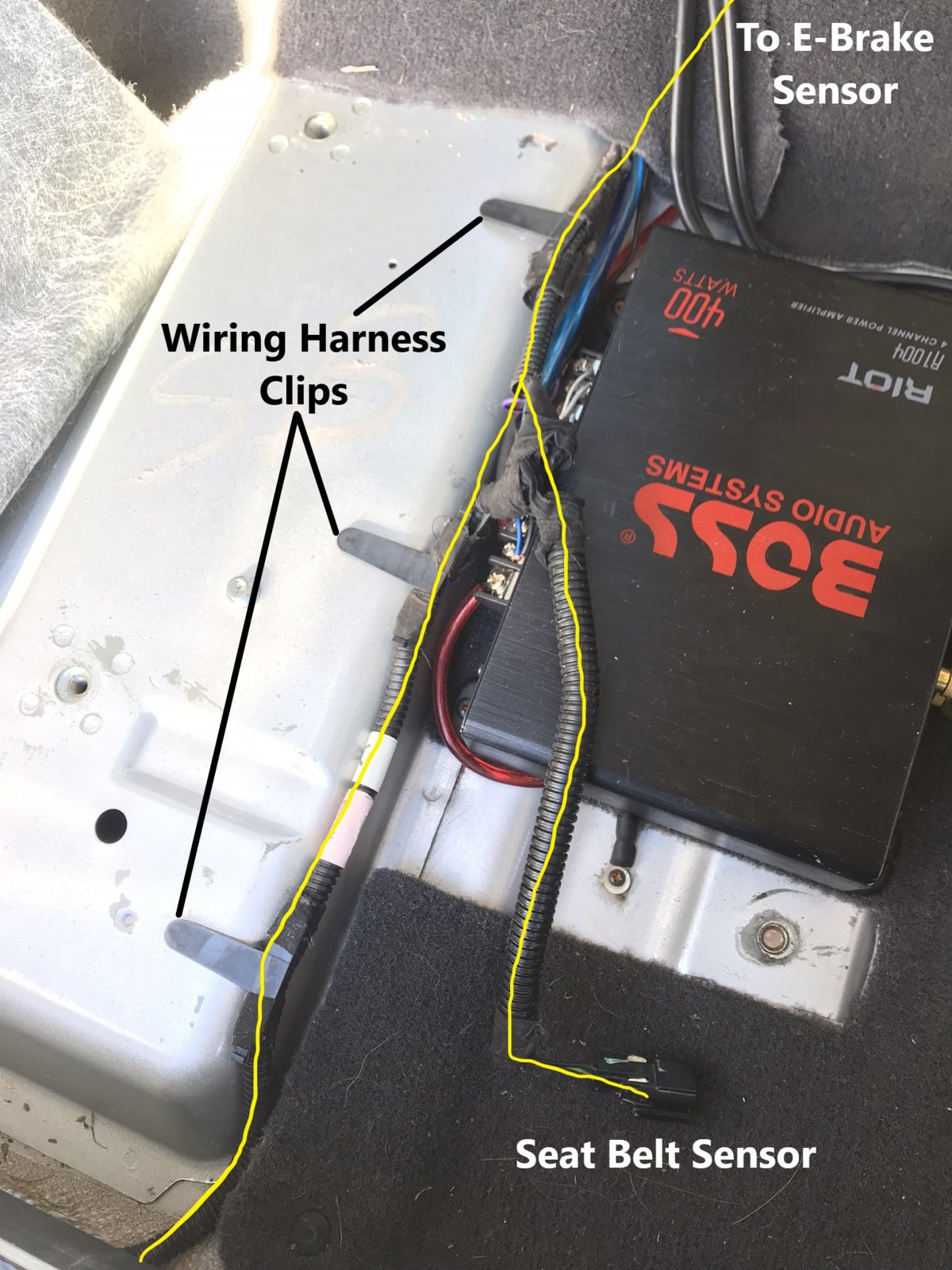 hight resolution of the e brake sensor is underneath the center console disconnect the plug and remove the wiring harness clip
