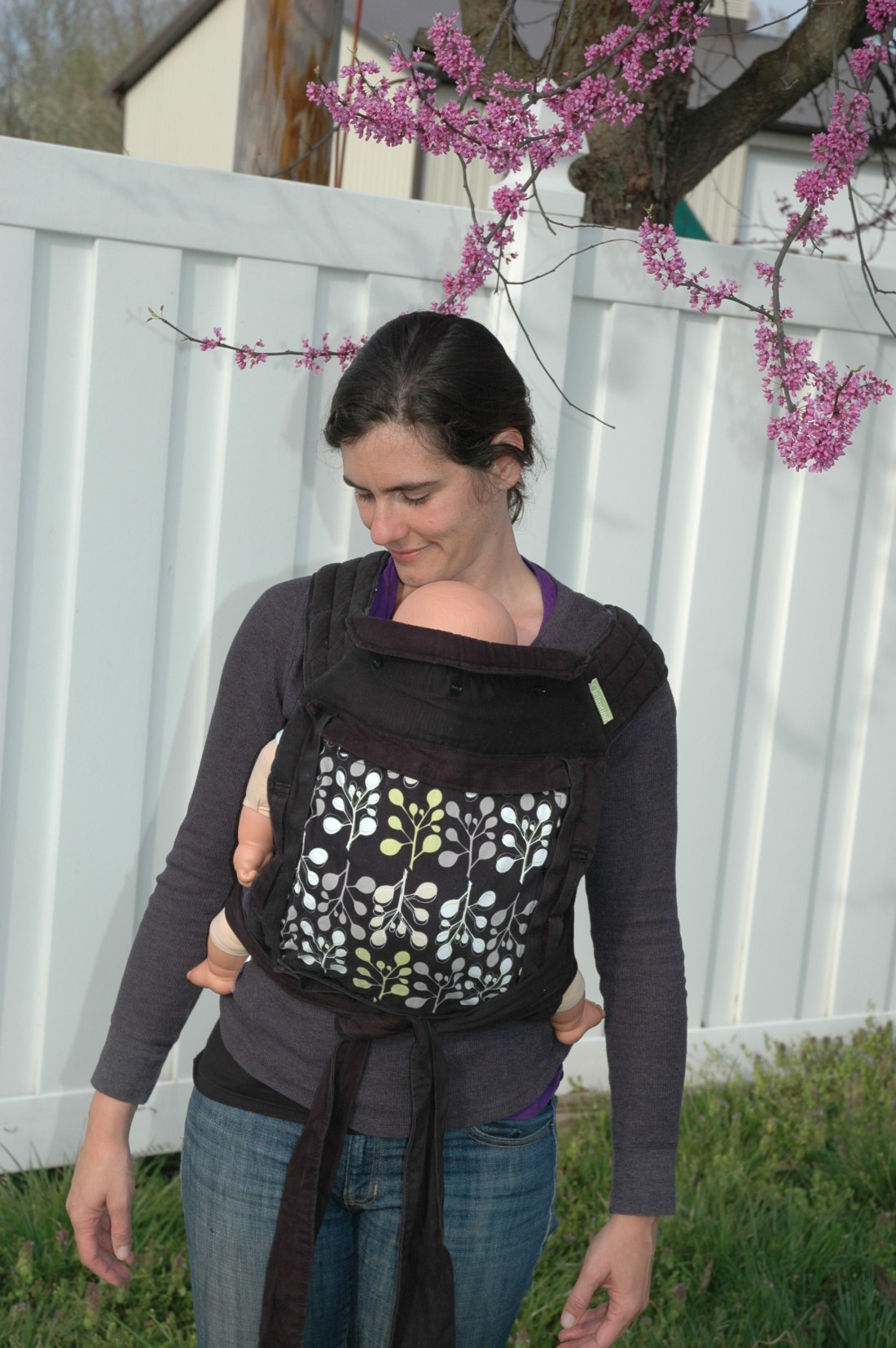 A meh dai front carry with shoulder straps tied under the baby's bottom