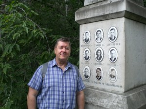 Keith McCloskey by a monument in memory of the nine  skiers. The black and white photo above shows a photo they took before tragedy struck.