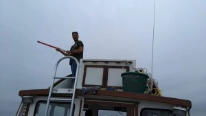 Matt putting up dive flag on Northern Voyager
