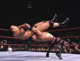 Chris Benoit hitting a German suplex on the Great One!