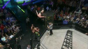 Galloway takes everyone out with a swanton off the penalty box.