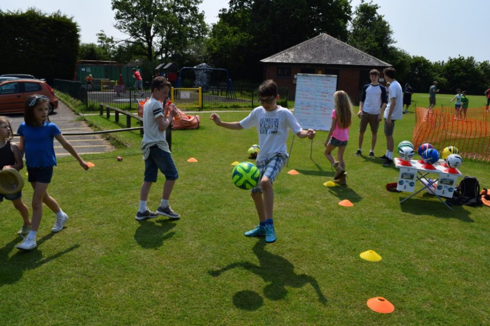 Alfie Shows Off His Skill On the U17 Keepy Uppy Competition Stall
