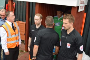 Officials and Players Emerge From the Dressing Room....