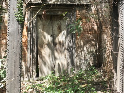 A near derelict door from the grounds of Tin Deval temple