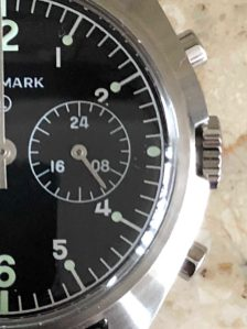 The crown does not screw down and is unsigned (which is period accurate) and the slight gap between it and the case is also accurate to the original. Pushers have a nice positive action and the meca-quartz VK64 movement instantly snaps the chronograph hand back to 12 O'clock with a satisfying click.