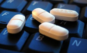 Image, Pills on a keyboard.