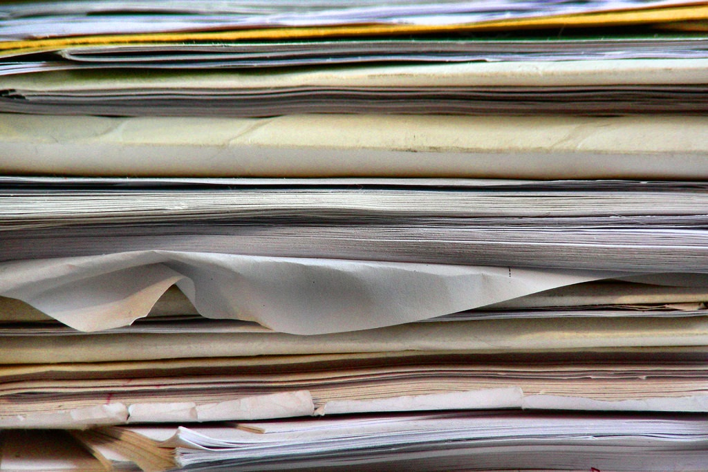 Image of a huge stack of papers.