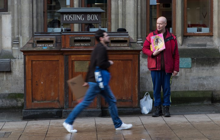 Image, A homeless Big Issue seller selling magazines in the rain.
