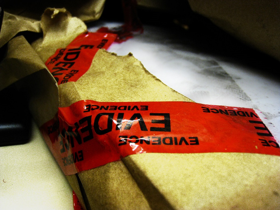 Image, Package wrapped in red evidence tape.