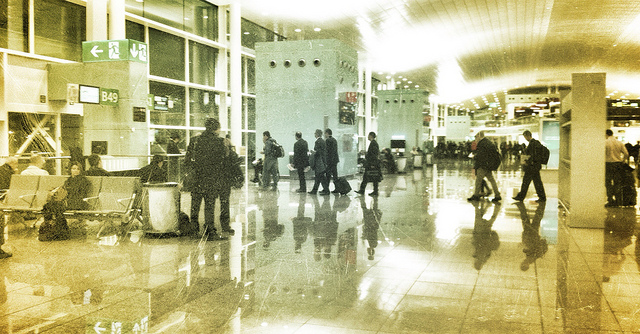Image, People lining up at an airport gate.