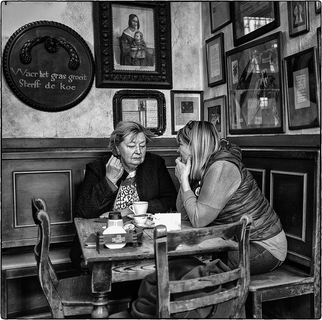 Image, two women gossiping in a cafe.