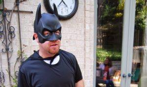 Image, man wearing batman costume.