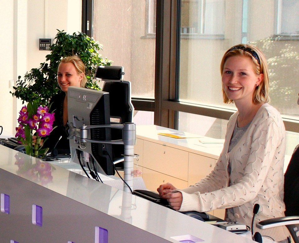 Image, receptionists at desk.