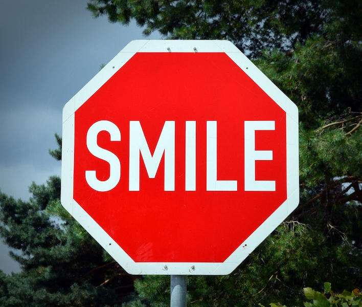 Image, Stop sign with 'SMILE' on it instead of 'STOP'.