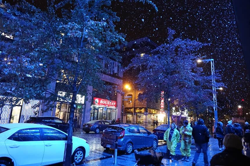 Image, Snow falling on a Montreal street scene at night.